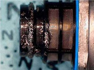 Metal contaminated fuel pressure regulator (Courtesy GM)